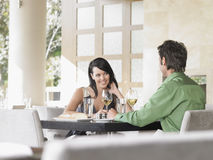 Couple Sharing Wine At Outdoor Restaurant Stock Photo