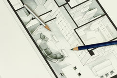 Couple of sharp pencils put on simple but elegant grey interior design architecture drawing Royalty Free Stock Photos