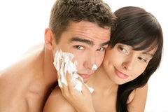 Couple with shaving cream. Portrait of young woman and her boyfriend with shaving cream on his face Stock Photo