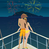 Couple on the ship admiring the fireworks over the island Royalty Free Stock Photography