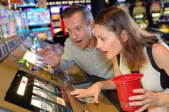 Couple shock with luck in casino Stock Photos