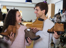 Couple in the shoe shop. Positive smiling couple in the shoe shop stock image