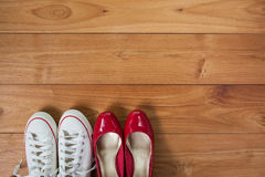 Couple shoes over wooden deck floor. A couple shoes over wooden deck floor stock image