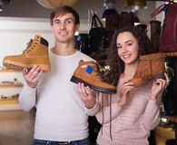 Couple with the shoes. In their hands royalty free stock image