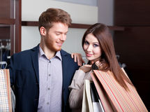 Couple in the shop admires each other Royalty Free Stock Photo