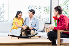 Couple with shop assistant in furniture store Stock Image