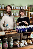 A couple shop for natural healing products Royalty Free Stock Photo
