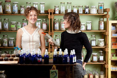 A couple shop for natural healing products Royalty Free Stock Photos