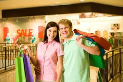 Couple of shopaholics Stock Images
