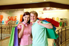 Couple of shopaholics Stock Photos