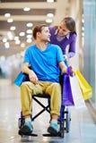 Couple of shopaholics Stock Image