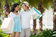 Couple of shopaholics Royalty Free Stock Image