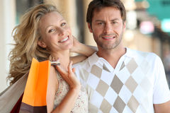Couple shopping. A couple with shopping bags Stock Photo