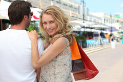 Couple shopping. With shopping bags in the street Stock Photography