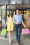 Couple after shopping Stock Images