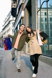 Couple in shopping. Couple in love enjoying holiday shopping royalty free stock images