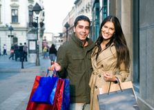 Couple in shopping. Young couple doing shopping at the city center royalty free stock photography