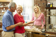 Couple shopping in antique shop Royalty Free Stock Image