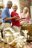 Couple shopping in antique shop Stock Image