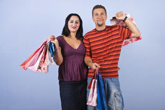 Couple with shopping bags. Smiling couple  holding shopping bags on blue background.Check also Shopping people Royalty Free Stock Photography