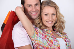 Couple with shopping bags Royalty Free Stock Images
