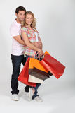 Couple with shopping bags. Isolated on white Royalty Free Stock Image