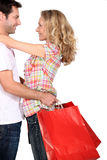 Couple with shopping bags. Hugging Royalty Free Stock Images