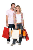 Couple with shopping bags. Couple with lots of shopping bags Royalty Free Stock Photography