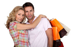 Couple with shopping bags. Happy couple with shopping bags Royalty Free Stock Images