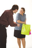 Couple with shopping bags. Over white Stock Photo