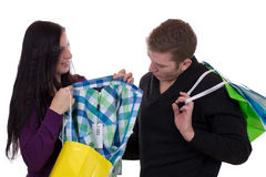 Couple with shopping bags buying clothes Stock Photos