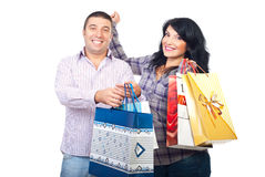 Couple with shopping bags cheering Stock Image