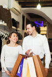 Couple with shopping bags. At fashion boutique Stock Photos