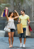 Couple with shopping bags in hands Royalty Free Stock Photos