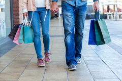 Couple with shopping bags holding hands Stock Photo