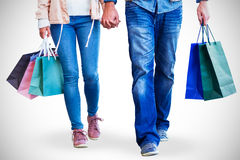 Couple with shopping bags holding hands Royalty Free Stock Image