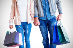 Couple with shopping bags holding hands Stock Photography