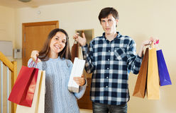 Couple  with shopping bags at home Stock Photos