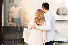 Couple with shopping bags looking at shop window Stock Photography