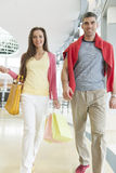 Couple with shopping bags in mall royalty free stock photo