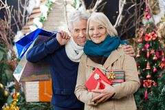 Couple With Shopping Bags And Present At Christmas Stock Photography