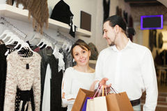 Couple with shopping bags at shop. Cheerful couple with shopping bags at clothing shop Stock Photo