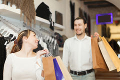 Couple with shopping bags at shop. Couple with shopping bags at clothing shop Royalty Free Stock Photography
