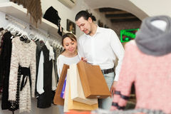 Couple with shopping bags at shop. Couple with shopping bags at clothing shop together Royalty Free Stock Image