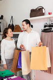 Couple with shopping bags at shop Stock Image