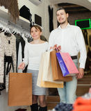 Couple with shopping bags at shop Stock Photography