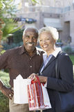 Couple With Shopping Bags On Shopping Trip Royalty Free Stock Images