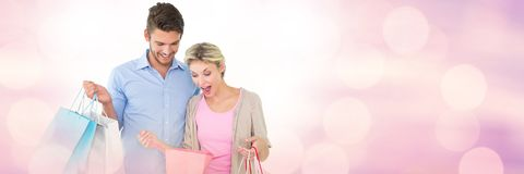 Couple shopping with bags and sparkling lights bokeh transition royalty free stock photos