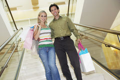 Couple With Shopping Bags On Staircase Royalty Free Stock Photo