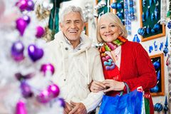 Couple With Shopping Bags Standing At Christmas Stock Image